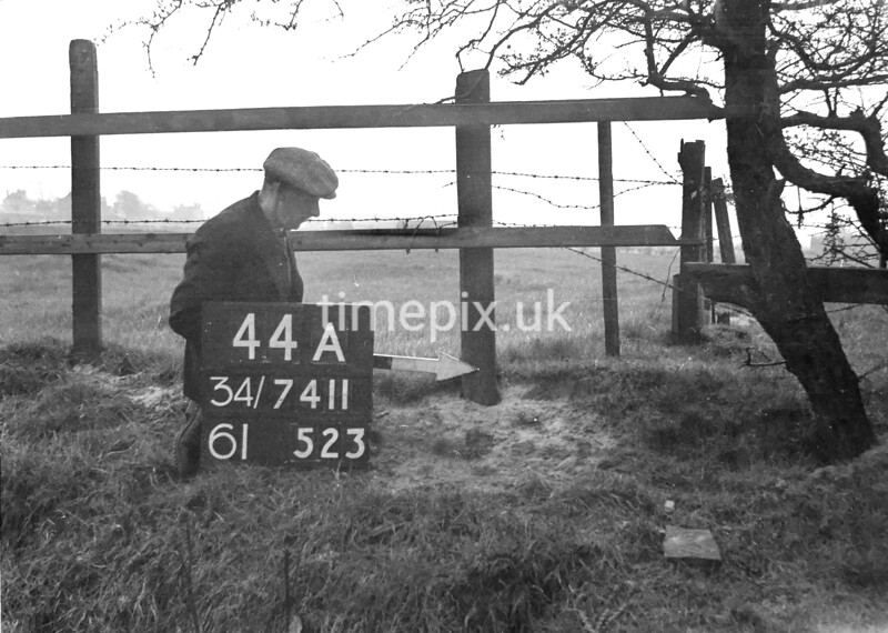 SD741144A, Man marking Ordnance Survey minor control revision point with an arrow in 1940s