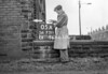 SD731105A, Man marking Ordnance Survey minor control revision point with an arrow in 1940s