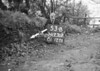 SD731253B, Man marking Ordnance Survey minor control revision point with an arrow in 1940s