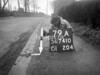 SD741079A, Man marking Ordnance Survey minor control revision point with an arrow in 1940s