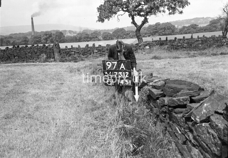 SD731297A, Man marking Ordnance Survey minor control revision point with an arrow in 1950s