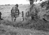 SD741102A, Man marking Ordnance Survey minor control revision point with an arrow in 1940s