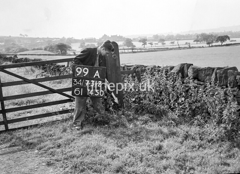 SD731299A, Man marking Ordnance Survey minor control revision point with an arrow in 1950s