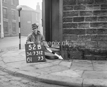 SD731252B, Man marking Ordnance Survey minor control revision point with an arrow in 1940s