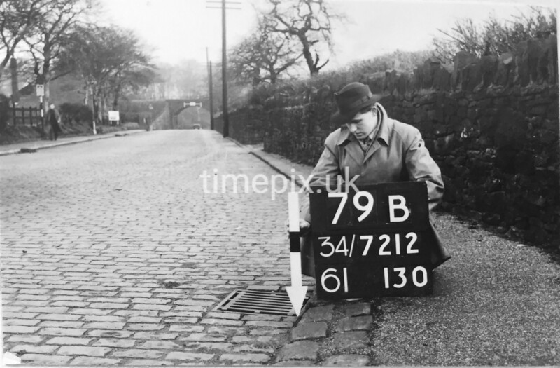 SD721279B, Man marking Ordnance Survey minor control revision point with an arrow in 1940s