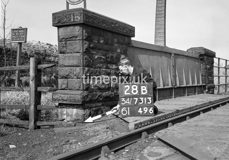 SD731328B, Man marking Ordnance Survey minor control revision point with an arrow in 1940s