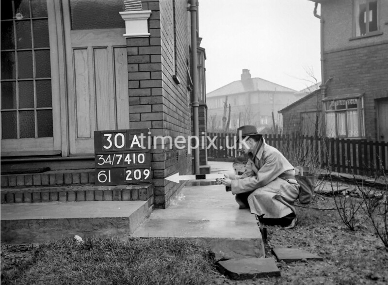 SD741030A, Man marking Ordnance Survey minor control revision point with an arrow in 1940s