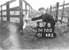 SD721287B, Man marking Ordnance Survey minor control revision point with an arrow in 1940s