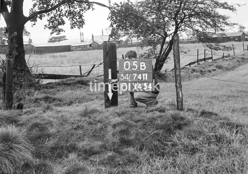 SD741105B, Man marking Ordnance Survey minor control revision point with an arrow in 1950s