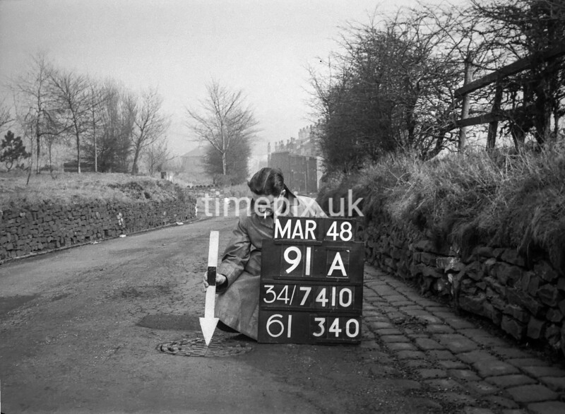 SD741091A, Man marking Ordnance Survey minor control revision point with an arrow in 1940s
