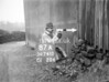 SD741087A, Man marking Ordnance Survey minor control revision point with an arrow in 1940s