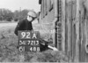 SD721392A, Man marking Ordnance Survey minor control revision point with an arrow in 1940s
