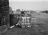 SD741083B, Man marking Ordnance Survey minor control revision point with an arrow in 1940s
