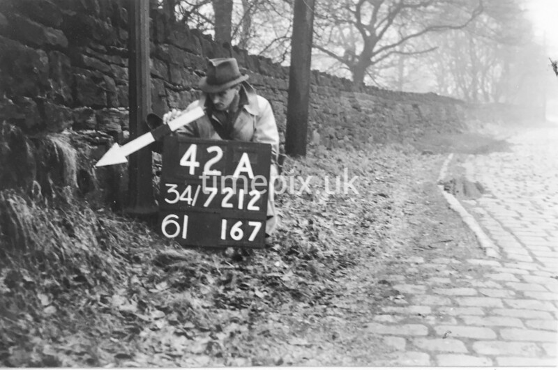 SD721242A, Man marking Ordnance Survey minor control revision point with an arrow in 1940s