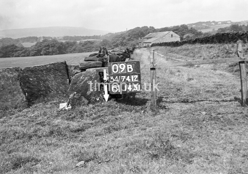 SD741209B, Man marking Ordnance Survey minor control revision point with an arrow in 1950s