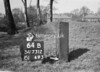SD731264B1, Man marking Ordnance Survey minor control revision point with an arrow in 1940s