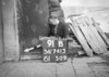 SD741391B, Man marking Ordnance Survey minor control revision point with an arrow in 1950s