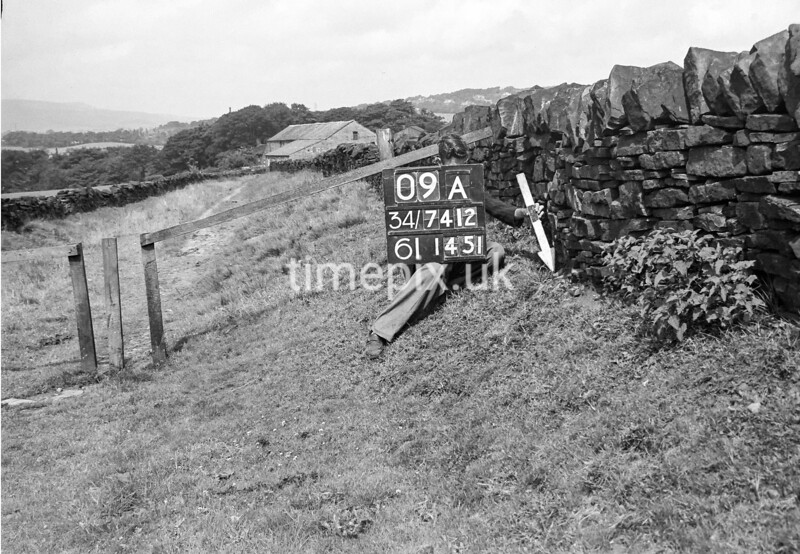 SD741209A, Man marking Ordnance Survey minor control revision point with an arrow in 1950s