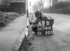 SD741069B, Man marking Ordnance Survey minor control revision point with an arrow in 1940s
