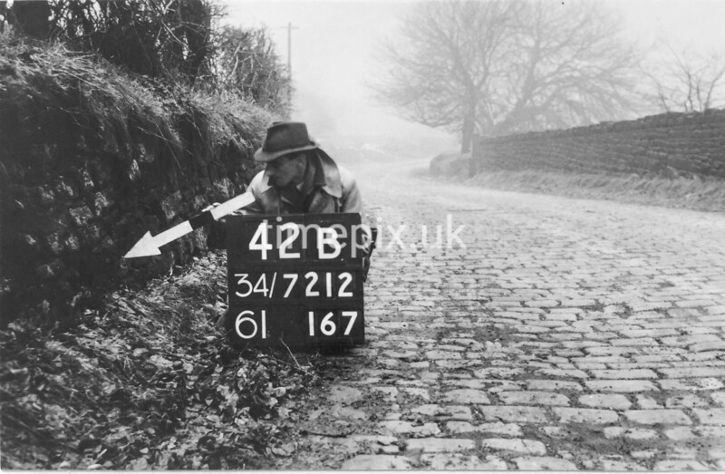 SD721242B, Man marking Ordnance Survey minor control revision point with an arrow in 1940s