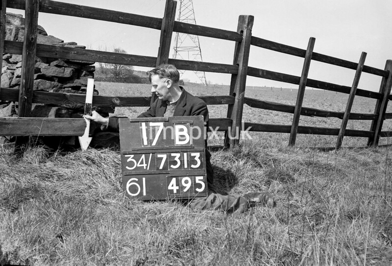 SD731317B, Man marking Ordnance Survey minor control revision point with an arrow in 1940s