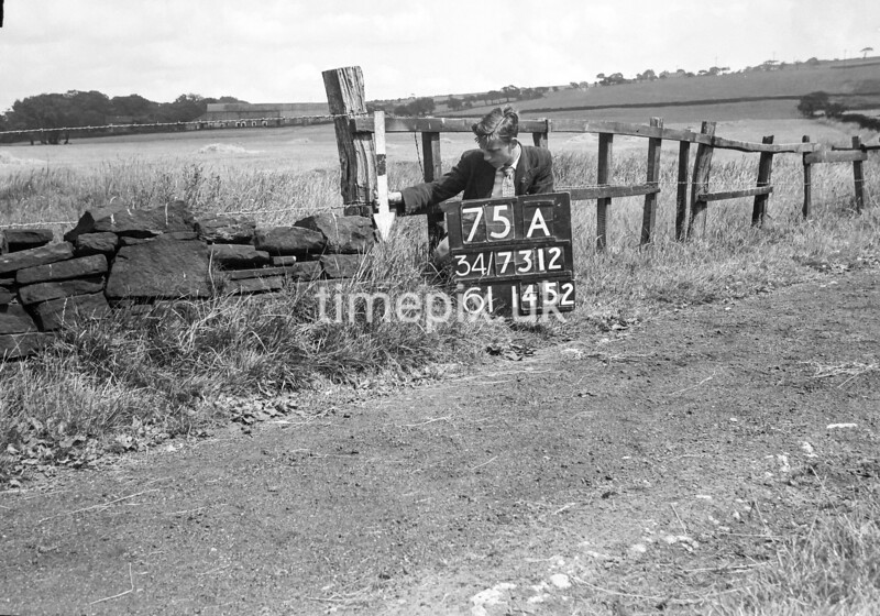 SD731275A, Man marking Ordnance Survey minor control revision point with an arrow in 1950s