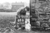 SD721268B, Man marking Ordnance Survey minor control revision point with an arrow in 1940s
