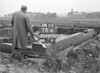 SD741076A, Man marking Ordnance Survey minor control revision point with an arrow in 1950s