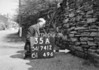 SD741235A, Man marking Ordnance Survey minor control revision point with an arrow in 1950s