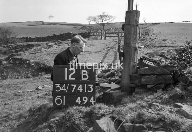 SD731312B, Man marking Ordnance Survey minor control revision point with an arrow in 1940s