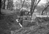 SD731217A1, Man marking Ordnance Survey minor control revision point with an arrow in 1940s
