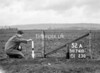 SD741052A, Man marking Ordnance Survey minor control revision point with an arrow in 1940s