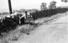 SD721430B, Man marking Ordnance Survey minor control revision point with an arrow in 1950s