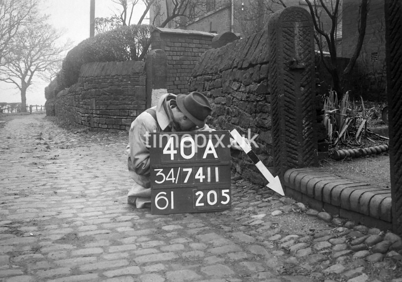 SD741140A, Man marking Ordnance Survey minor control revision point with an arrow in 1940s