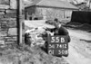 SD741255B, Man marking Ordnance Survey minor control revision point with an arrow in 1950s