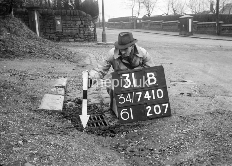 SD741031B, Man marking Ordnance Survey minor control revision point with an arrow in 1940s