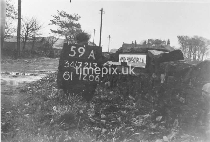 SD721359A, Man marking Ordnance Survey minor control revision point with an arrow in 1940s