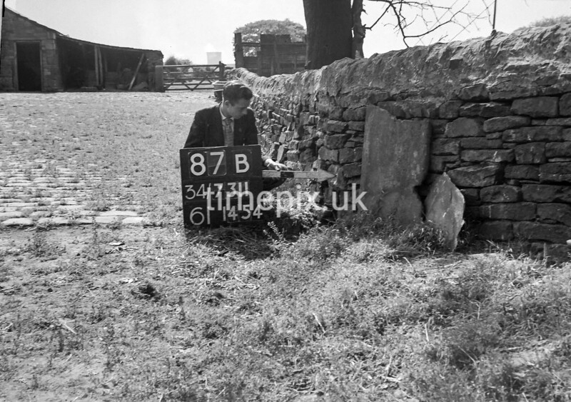 SD731187B, Man marking Ordnance Survey minor control revision point with an arrow in 1950s