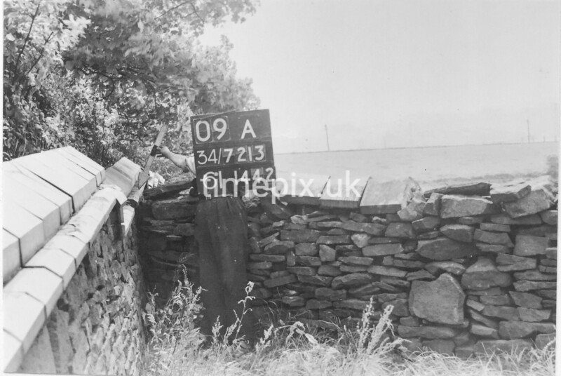 SD721309A, Man marking Ordnance Survey minor control revision point with an arrow in 1950s