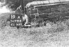 SD721319A, Man marking Ordnance Survey minor control revision point with an arrow in 1950s