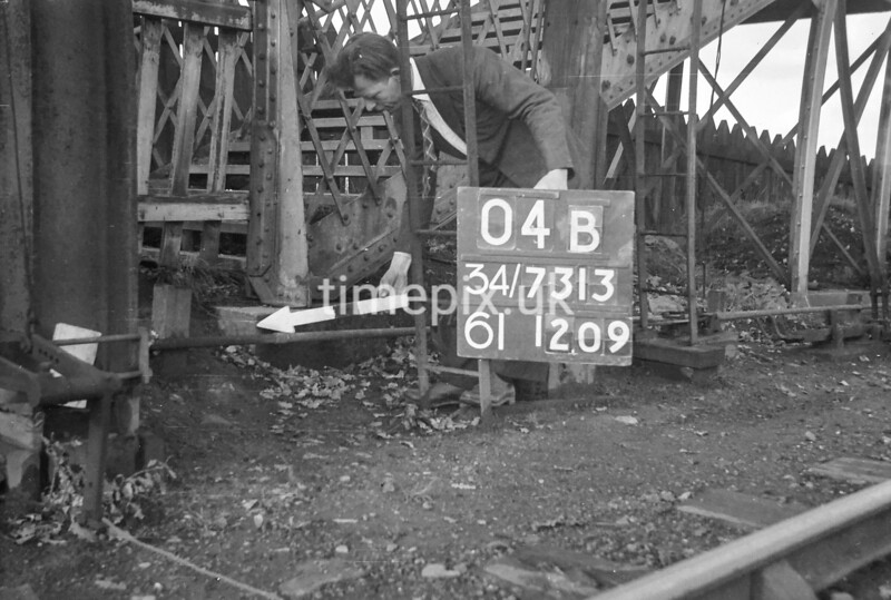 SD731304B, Man marking Ordnance Survey minor control revision point with an arrow in 1940s
