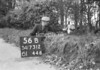 SD731256B, Man marking Ordnance Survey minor control revision point with an arrow in 1940s
