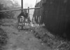 SD731217K, Man marking Ordnance Survey minor control revision point with an arrow in 1940s