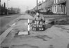 SD741139A, Man marking Ordnance Survey minor control revision point with an arrow in 1940s