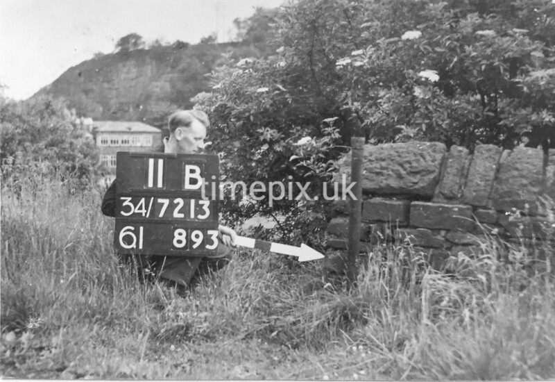 SD721311B, Man marking Ordnance Survey minor control revision point with an arrow in 1940s