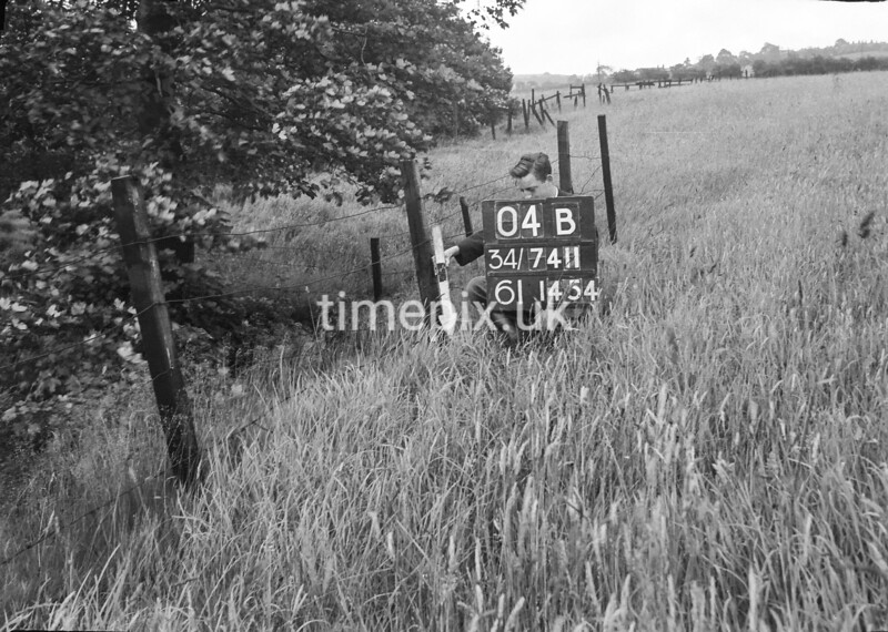 SD741104B, Man marking Ordnance Survey minor control revision point with an arrow in 1950s