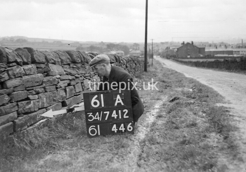 SD741261A, Man marking Ordnance Survey minor control revision point with an arrow in 1950s