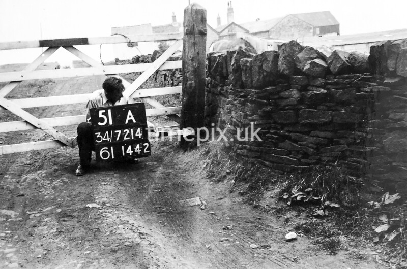 SD721451A, Man marking Ordnance Survey minor control revision point with an arrow in 1950s