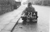 SD721323A, Man marking Ordnance Survey minor control revision point with an arrow in 1940s