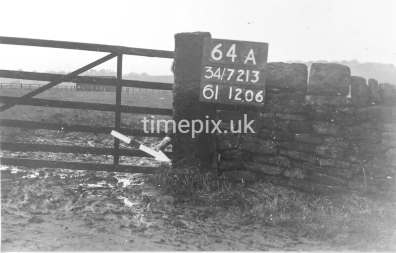 SD721364A, Man marking Ordnance Survey minor control revision point with an arrow in 1940s